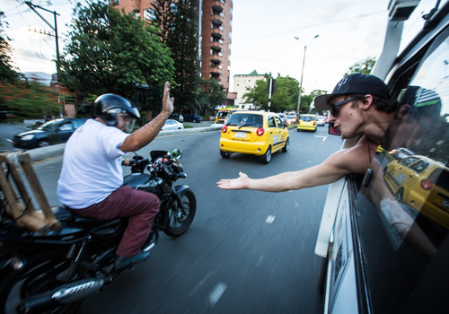 high five with motorcycle driver