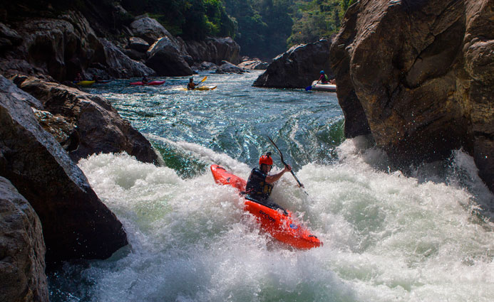 kayaker entering class 4 rapid