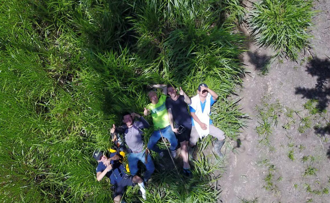 5 men relaxing in grass