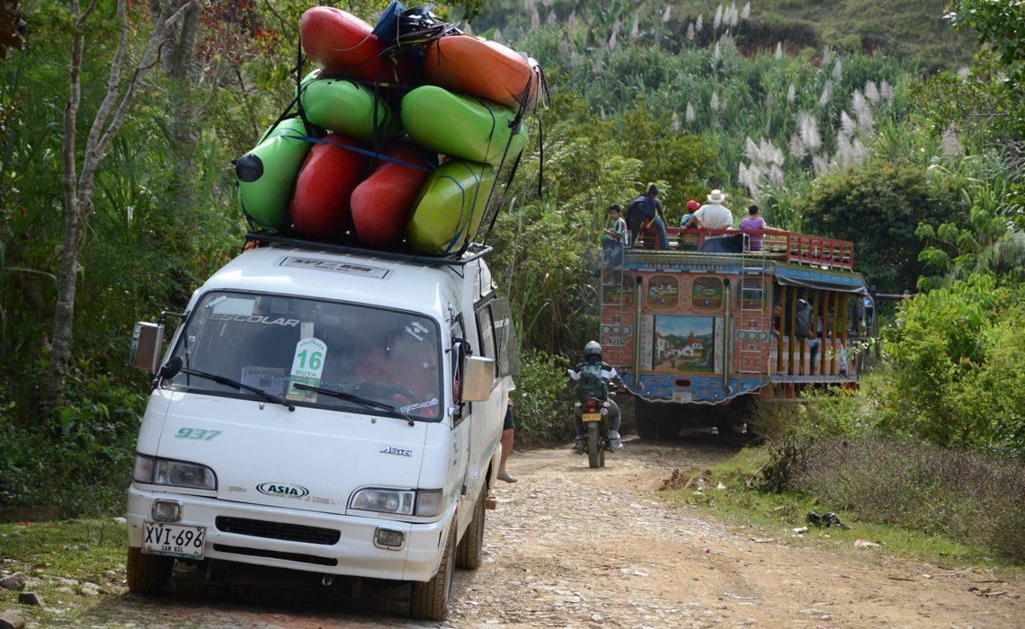 van with kayaks and chiva