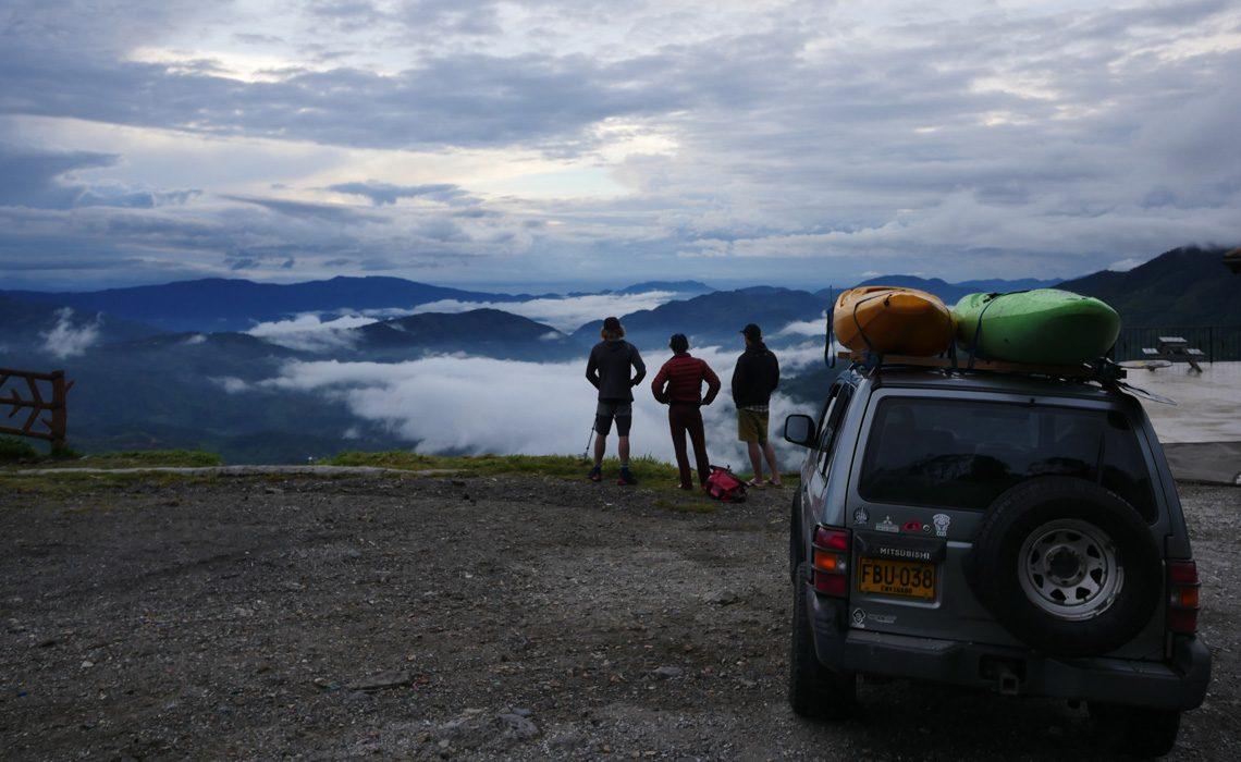 kayaks loaded on SUV at a mirador