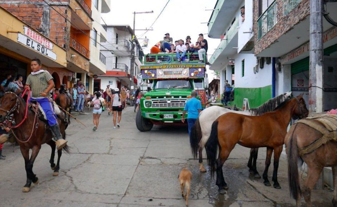 colombian chiva and horse