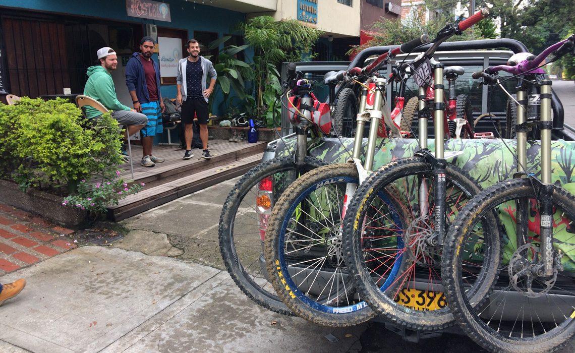 mountain bikers outside hostel