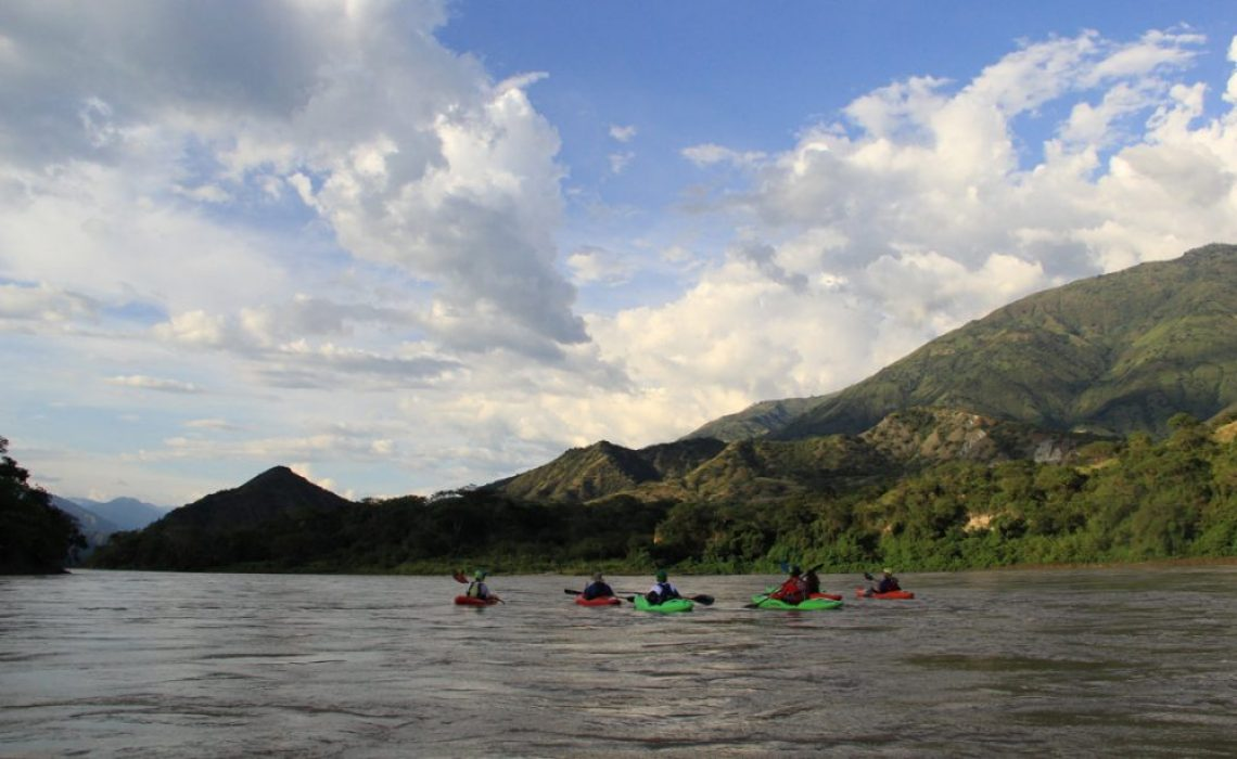 Group paddling into canyon of Cauca