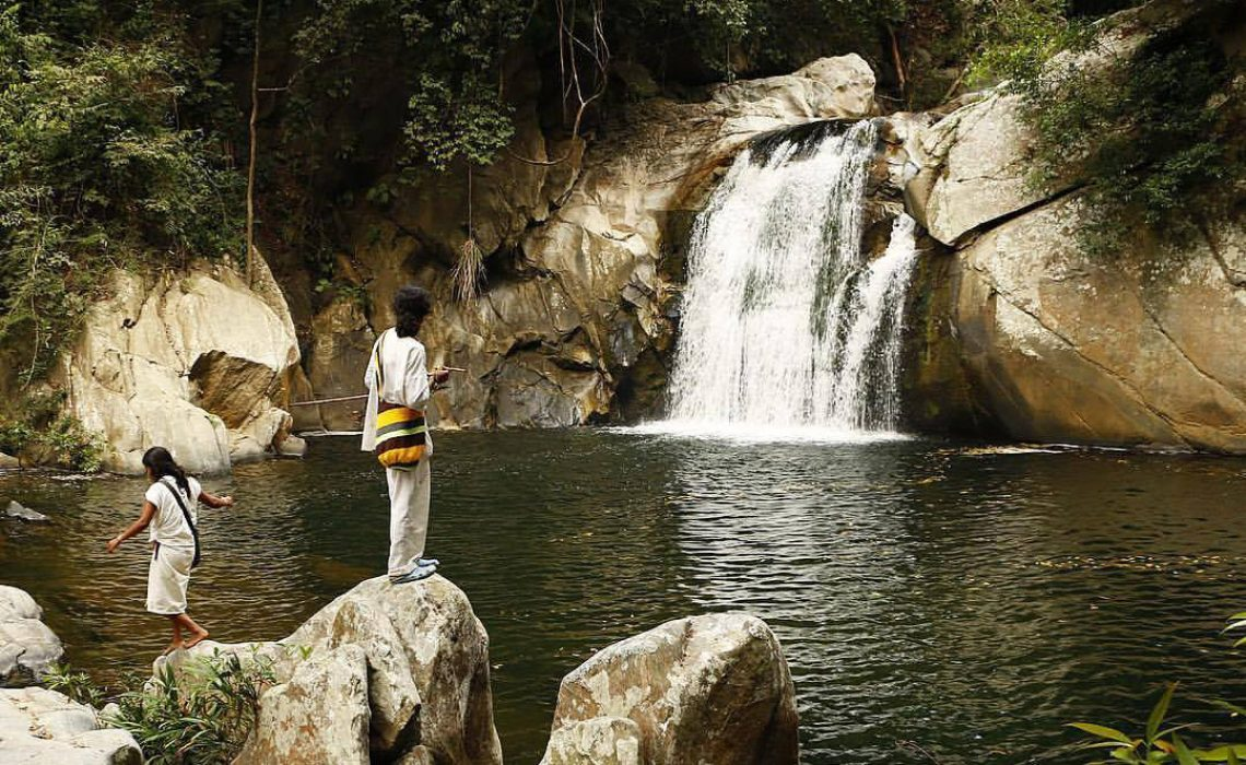 waterfalls and indigenous children