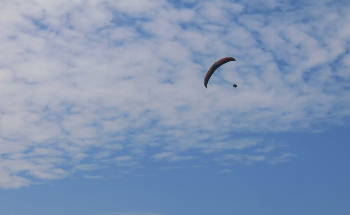 paraglider with blue sky
