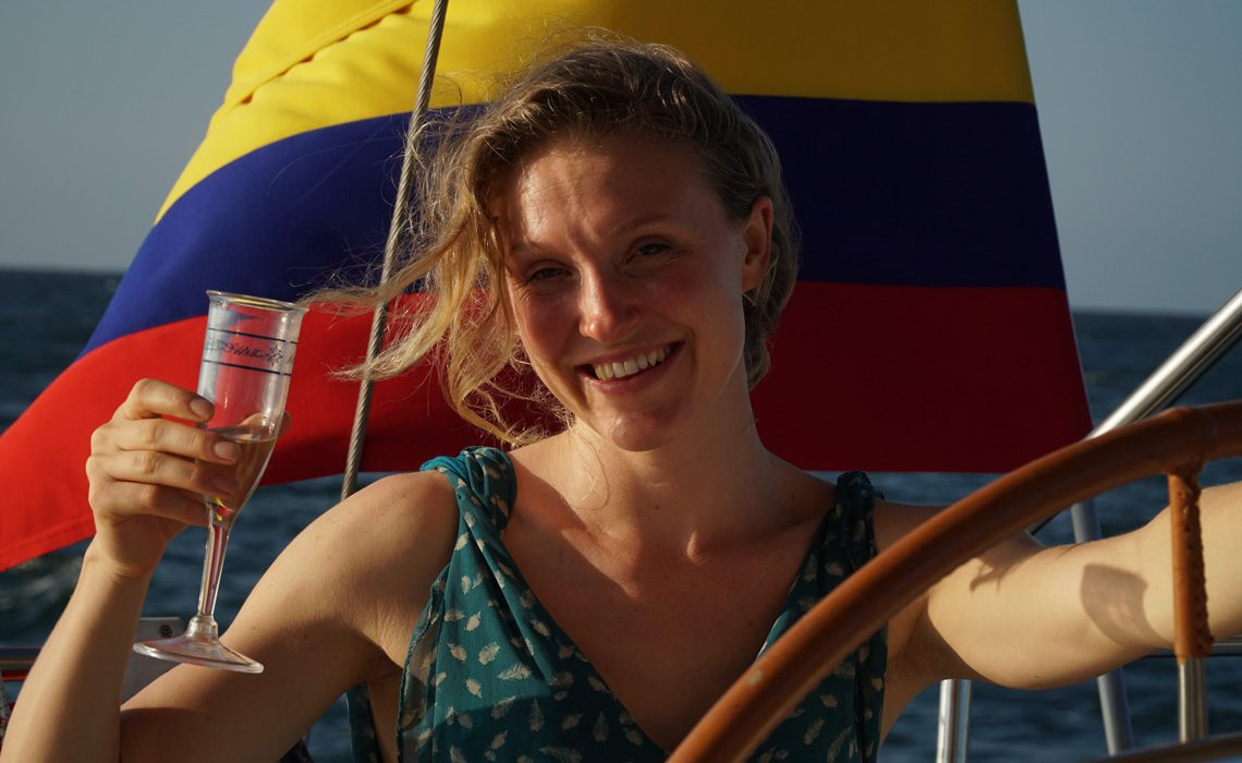 woman happy sailing colombian flag