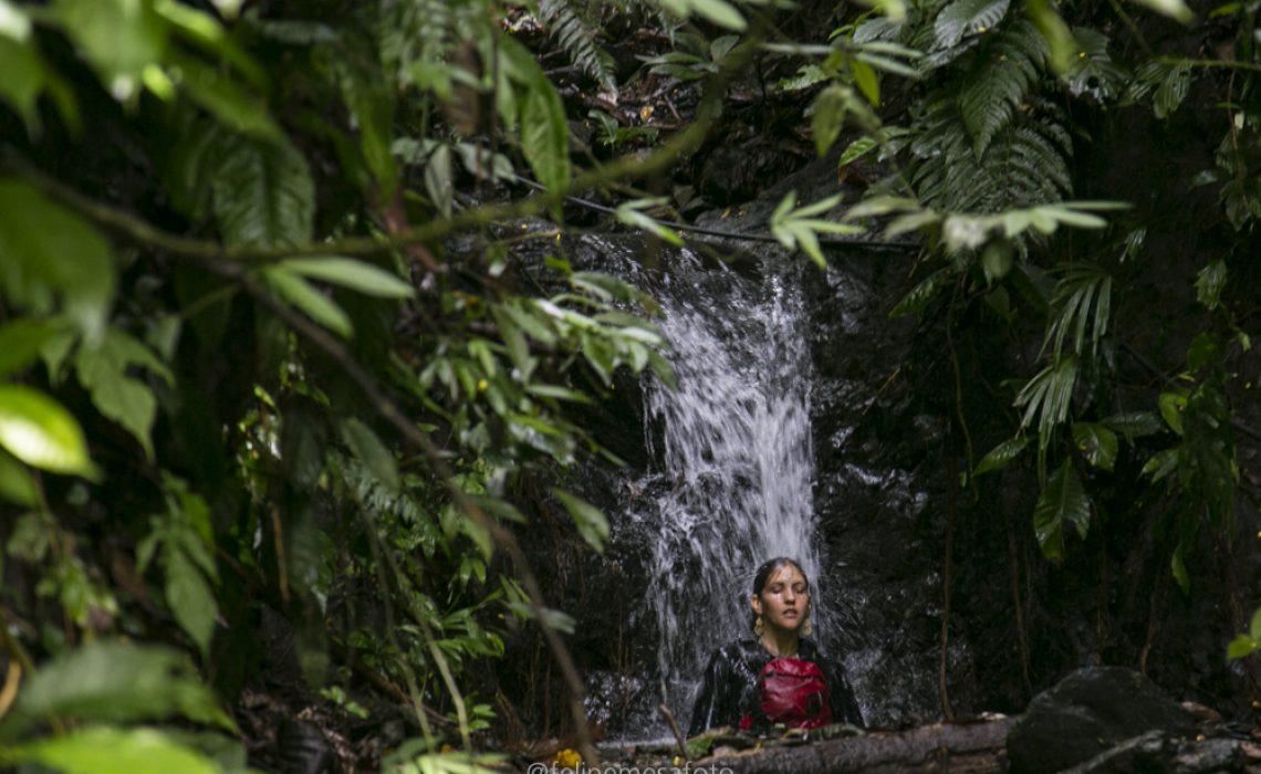 woman waterfall jungle