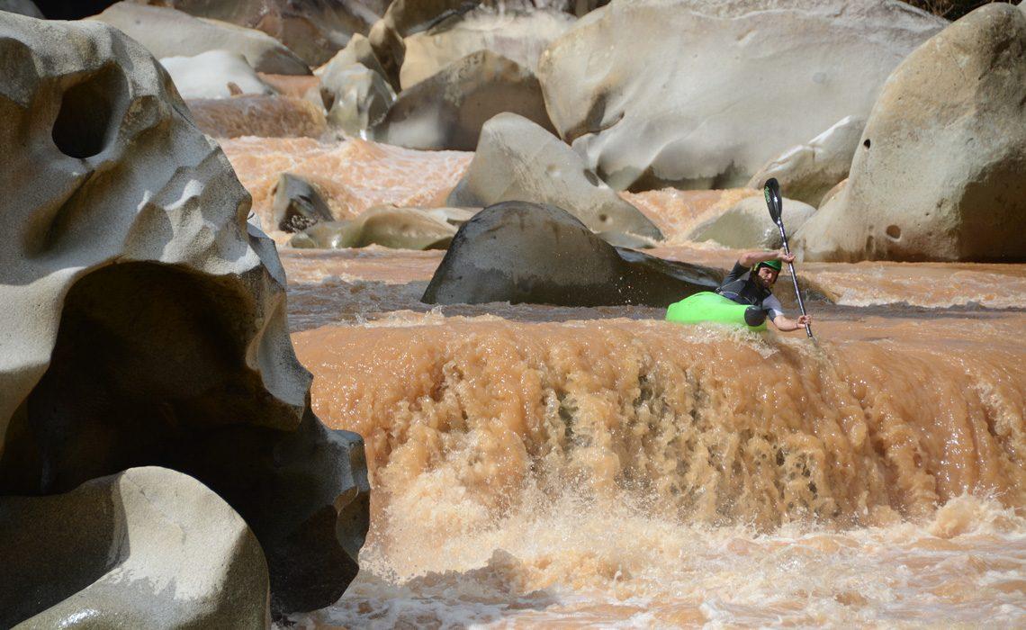 kayaker going over waterfall